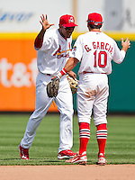 Oscar Taveras (25) of the Springfield Cardinals high fives Greg Garcia (10) during a game against the Arkansas Travelers at Hammons Field on May 8, 2012 in Springfield, Missouri. (David Welker/ Four Seam Images)