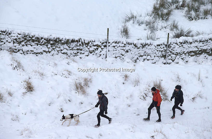 17/01/16<br /> Walkers make their way up to Mam Tor after overnight snowfall near Edale in the Derbyshire Peak District.<br /> <br /> All Rights Reserved: F Stop Press Ltd. +44(0)1335 418365   +44 (0)7765 242650 www.fstoppress.com