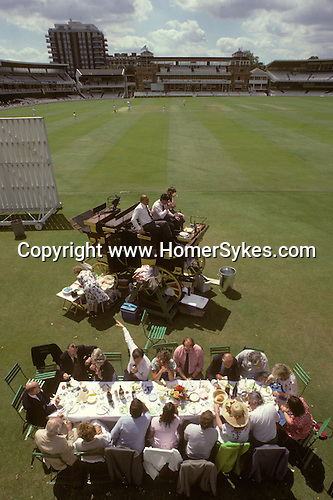 Eton Harrow cricket match picnic during the lunch break.  Lords London. The English Season published by Pavilon Books 1987