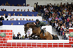August 08, 2009: Eddie Moloney (IRL) aboard Highlander competing in the Puissance event. Land Rover International Puissance. Failte Ireland Horse Show. The RDS, Dublin, Ireland.