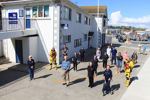 Dunmore East RNLI volunteers with author David Carrol and his family at the lifeboat station | Credit: RNLI/Neville Murphy