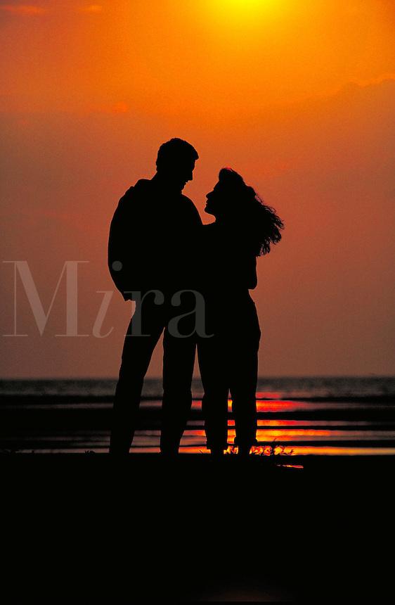 COUPLE WATCHING SUNSET,