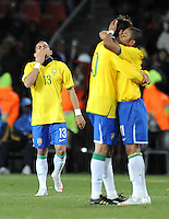 Goalscorer Dani Alves of Brazil looks emotional at full-time as team-mates Kaka and Robinho embrace. Brazil defeated South Africa 1-0 during the semi-finals of the FIFA Confederations Cup at Ellis Park Stadium in Johannesburg, South Africa on June 25, 2009..