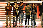 """Tokyo, Dec. 30, 2009 - Japanese boy band ARASHI is photographed during the second day of rehearsals for 'Kohaku Uta Gassen,' or also more commonly known as 'Kohaku.' Produced by the Japanese public broadcaster, NHK, this annual music show airs on New Year's Eve and ends shortly before midnight, where everyone on air pauses to say """"Happy New Year."""" The 'Red and White Song Battle' separates the most popular music artists during each given year into teams of red and white: the red team consists of all female artists and the white team is all male artists. For an artist to perform on Kohaku, it is a great honor as only the most successful enka singers and J-Pop artist are strictly invited to perform by invitation only. Today, for a J-Pop artist or enka singer to perform on Kohaku, is most notably recognized to be a big highlight in a singer's career due to the show's large reach of audience during New Year's Eve."""