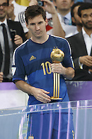 Lionel Messi of Argentina with the Golden Ball trophy