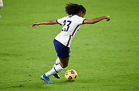 ORLANDO, FL - JANUARY 18: Margaret Purce #23 of the United States turns and moves with the ball during a game between Colombia and USWNT at Exploria Stadium on January 18, 2021 in Orlando, Florida.