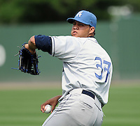 Pitcher Albert Campos (37) of the Asheville Tourists, Class A affiliate of the Colorado Rockies, in a game against the Greenville Drive on May 1, 2011, at Fluor Field at the West End in Greenville, S.C. Photo by Tom Priddy / Four Seam Images