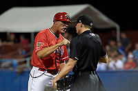 Batavia Muckdogs manager Mike Jacobs (17) argues with a home plate umpire Tyler Witte during a game against the West Virginia Black Bears on July 3, 2018 at Dwyer Stadium in Batavia, New York.  Batavia defeated West Virginia 5-4.  (Mike Janes/Four Seam Images)