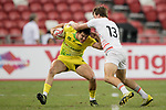 Simon Kennewell of Australia (left) competes for the ball with Harry Glover of England (right) during the match Australia vs England, the Bronze Final of Day 2 of the HSBC Singapore Rugby Sevens as part of the World Rugby HSBC World Rugby Sevens Series 2016-17 at the National Stadium on 16 April 2017 in Singapore. Photo by Victor Fraile / Power Sport Images