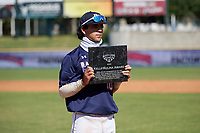 Marcelo Mayer (10) poses with the Kelly Kulina Award after the Baseball Factory All-Star Classic at Dr. Pepper Ballpark on October 4, 2020 in Frisco, Texas.  Marcelo Mayer (10), a resident of Chula Vista, California, attends Eastlake High School.  (Mike Augustin/Four Seam Images)