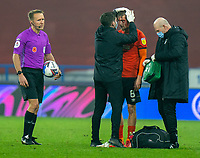 7th November 2020 The John Smiths Stadium, Huddersfield, Yorkshire, England; English Football League Championship Football, Huddersfield Town versus Luton Town; Luke Berry of Luton Town  receives treatment for head injury