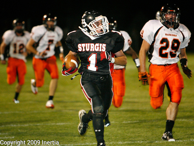 STURGIS, SD - SEPTEMBER 18, 2009 --   Jason Duprel #1 of Sturgis returns a recovered fumble for a touchdown in the second quarter against Sioux Falls Washington Friday evening at Woodle Field. (Photo by Dick Carlson/Inertia)