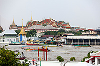 Bangkok, Thailand.  The King's Royal Grand Palace Compound seen across the Chao Phraya River from the Wat Arun.