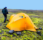 Anchoring the tent down with rocks while in a rain and wind storm in Iceland