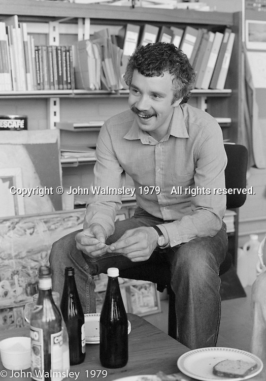 Tom Bonnar, Art Dept staff room, Wester Hailes Education Centre, Wester Hailes, Scotland, 1979.  John Walmsley was Photographer in Residence at the Education Centre for three weeks in 1979.  The Education Centre was, at the time, Scotland's largest purpose built community High School open all day every day for all ages from primary to adults.  The town of Wester Hailes, a few miles to the south west of Edinburgh, was built in the early 1970s mostly of blocks of flats and high rises.