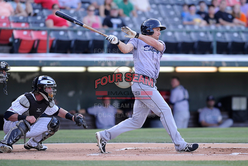 First baseman Cord Phelps (24) of the Columbus Clippers bats in a game against the Charlotte Knights on Saturday, June 15, 2013, at Knights Stadium in Fort Mill, South Carolina. The Charlotte catcher is Bryan Anderson. Columbus won, 4-2. (Tom Priddy/Four Seam Images)
