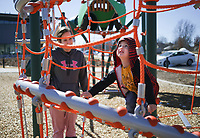 Sagan Gregory of Rogers (from left) watches Silas Hackett, 3, climb a jungle gym, February 22, 2021 at Osage Park in Bentonville. Check out nwaonline.com/210223Daily/ for today's photo gallery. <br /> (NWA Democrat-Gazette/Charlie Kaijo)
