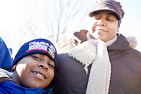 "Tawana Bowles and son Justin of Brooklyn, NY wait for President-Elect Barack Obama and Vice President-Elect Joe Biden to arrive in Wilmington, Delaware, a stop on the ""Whistle Stop Tour"" of January 17th, 2009."