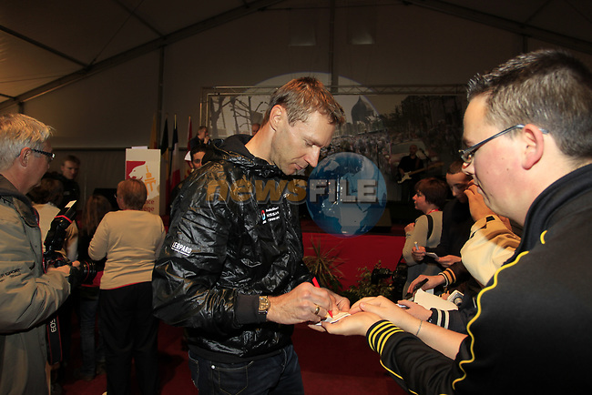 Jens Voigt (GER) Radioshack-Nissan signs autographs for fans at the team presentations at the Palais Provincial in Liege city centre before the 98th edition of Liege-Bastogne-Liege 2012. 21st April 2012.  <br /> (Photo by Eoin Clarke/NEWSFILE).