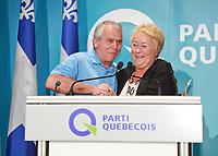 """PQ MNA Francois Gendron and Quebec Premier Pauline Marois shake hands at the """"Universite d'ete des jeunes du Parti Quebecois"""" event in Quebec City, Sunday August 25, 2013.<br /> <br /> PHOTO :  Francis Vachon - Agence Quebec Presse"""