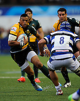 Luther Burrell of Northampton Saints looks to go past Leroy Houston of Bath Rugby during the Amlin Challenge Cup Final match between Bath Rugby and Northampton Saints at Cardiff Arms Park on Friday 23rd May 2014 (Photo by Rob Munro)