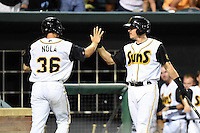 Jacksonville Suns catcher J.T. Realmuto (11) high fives Austin Nola (36) after scoring a run during game three of the Southern League Championship Series against the Chattanooga Lookouts on September 12, 2014 at Bragan Field in Jacksonville, Florida.  Jacksonville defeated Chattanooga 6-1 to sweep three games to none.  (Mike Janes/Four Seam Images)