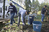 family working together in garden to clean up