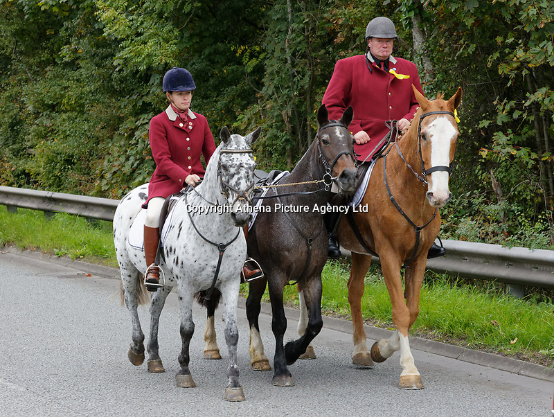 """Pictured: Byron John (R) with a horse owned by Bradley rides toward Margam Crematorium, Wales, UK. Monday 08 October 218<br /> Re: A grieving father will mourners on horseback at the funeral of his """"wonderful"""" son who killed himself after being bullied at school.<br /> Talented young horse rider Bradley John, 14, was found hanged in the school toilets by his younger sister Danielle.<br /> Their father, farmer Byron John, 53, asked the local riding community to wear their smart hunting gear at Bradley's funeral.<br /> Police are investigating Bradley's death at the 500-pupils St John Lloyd Roman Catholic school in Llanelli, South Wales.<br /> Bradley's family claim he had been bullied for two years after being diagnosed with Attention Deficit Hyperactivity Disorder.<br /> He went missing during lessons and was found in the toilet cubicle by his sister Danielle, 12."""