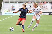 CARY, NC - APRIL 10: Ashley Sanchez #10 of the Washington Spirit is defended by Schuyler Debree #15 of the North Carolina Courage during a game between Washington Spirit and North Carolina Courage at Sahlen's Stadium at WakeMed Soccer Park on April 10, 2021 in Cary, North Carolina.