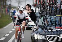 Stijn Devolder (BEL/Trek Factory Racing) is getting hi radio checked on the fly<br /> <br /> 71st Dwars door Vlaanderen (1.HC)