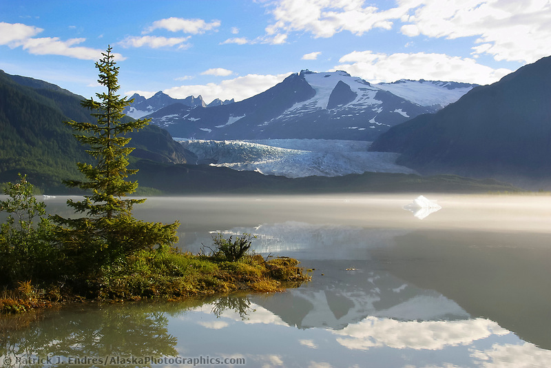 Mendenhall Glacier terminus, Juneau, Alaska. it originates on the western snowfields of the taku range at an elevation of 5,500 feet and flows down to 100 feet above sea level.