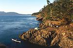 San Juan Islands, Sea kayakers paddling, camping on Strawberry Island, Rosario Strait, Washington State, Pacific Northwest, Cascadia Marine Trail, site..