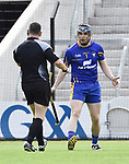 Donal Tuohy of Clare is spoken to by referee Fergal Horgan during their All-Ireland quarter final at Pairc Ui Chaoimh. Photograph by John Kelly.