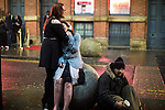 """© Joel Goodman - 07973 332324 . 17/12/2016 . Manchester , UK . Two woman hug on Dantzic Street , outside the Printworks . Revellers out in Manchester City Centre overnight during """" Mad Friday """" , named for being one of the busiest nights of the year for the emergency services in the UK . Photo credit : Joel Goodman"""