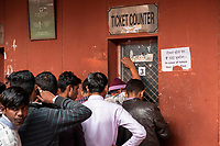Men wait in line at the ticket counter at the entrance of the Red Fort in Delhi, India, on Tue., Dec. 11, 2018.