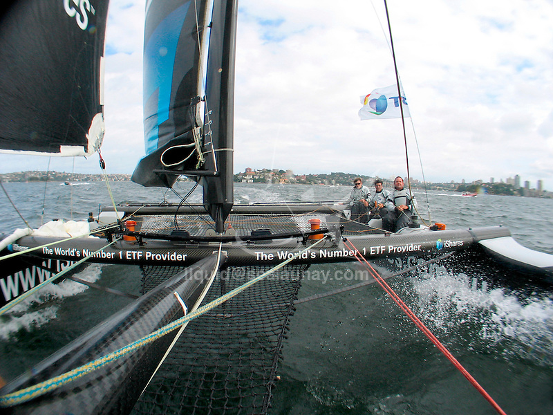 Onboard an Extreme 40 during a presentation of the catamaran  in Australia, Sydney Harbour..The Extreme 40 was created with two things in mind, action and adrenline! The gap was seen in the Grand Prix sailing market for a fast, inshore catamaran, which would be not only exciting to watch but cost effective to run. TornadoSport created the concept of the Extreme 40 with Yves Loday designing the racing machine..The concept is to build an easy to sail, light weight, fully carbon fibre racing weapon. The boat will fit inside a normal 40ft shipping container on its own road trailer