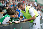 Hibs v St Johnstone...25.08.12   SPL.Shefki Kuqi signs autographs for young Hibs fans.Picture by Graeme Hart..Copyright Perthshire Picture Agency.Tel: 01738 623350  Mobile: 07990 594431