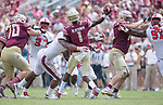 Florida State quarterback James Blackman takes a hit from North Carolina State defensive ends Bradley Chubb as he releases the ball in the second half of an NCAA college football game in Tallahassee, Fla., Saturday, Sept. 23, 2017.  NC State defeated Florida State 27-21. (AP Photo/Mark Wallheiser)