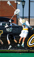 3 April 2010: University of Vermont Catamounts' Attacker Derek Lichtfuss, a Junior from Lutherville, MD, jumps high to gain possession against Jordan Marra of the Binghamton University Bearcats at Moulton Winder Field in Burlington, Vermont. The Catamounts defeated the visiting Bearcats 11-8 in Vermont's opening home game of the 2010 season. Mandatory Credit: Ed Wolfstein Photo