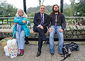 First Minister Alex Salmond has a mixed reaction at a bus stop whilst on the campaign trail in Ellon. A bearded man takes his earphones out only briefly to listen to him, while an old woman tells Alex that she's voting no.