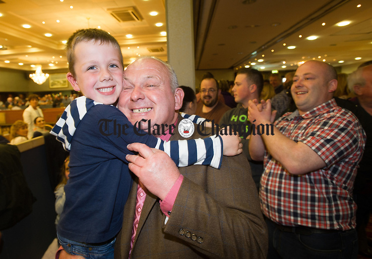 PJ Ryan of Fianna Fail celebrates his win with his grandson Cathal Ryan during the election count at The West county Hotel, Ennis. Photograph by John Kelly.