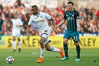 Jordan Ayew of Swansea City breaks free of the Southampton defence during the Premier League match between Swansea City and Southampton at Liberty Stadium, Swansea, Wales, UK. Tuesday 08 May 2018