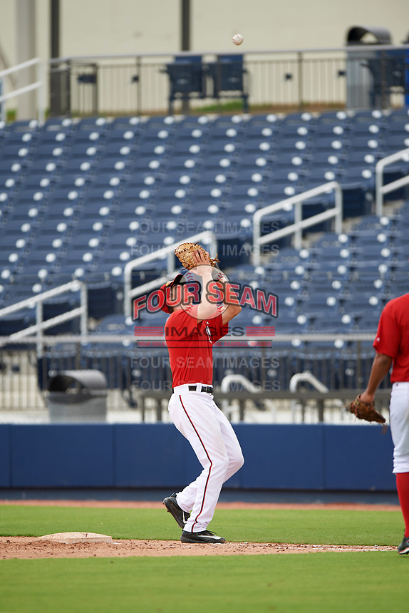 GCL Nationals first baseman Jackson Cramer (25) catches a popup in foul territory during the second game of a doubleheader against the GCL Mets on July 22, 2017 at The Ballpark of the Palm Beaches in Palm Beach, Florida.  GCL Mets defeated the GCL Nationals 4-1.  (Mike Janes/Four Seam Images)