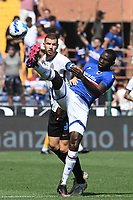Edin Dzeko of FC Internazionale and Omar Cooleyof UC Sampdoria compete for the ball during the Serie A football match between UC Sampdoria and FC Internazionale at stadio Marassi in Genova (Italy), September 12th, 2021. Photo Image Sport / Insidefoto