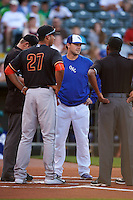 Oklahoma City Dodgers Austin Chubb during the lineup exchange with Carlos Correa (27) before a game against the Fresno Grizzles on June 1, 2015 at Chickasaw Bricktown Ballpark in Oklahoma City, Oklahoma.  Fresno defeated Oklahoma City 14-1.  (Mike Janes/Four Seam Images)
