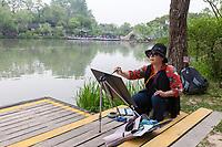 Yangzhou, Jiangsu, China.  Artist at Work in the Slender West Lake Park.