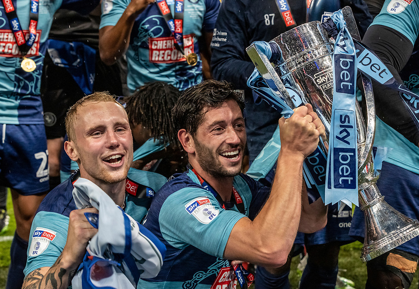 Wycombe Wanderers' Joe Jacobson holds the trophy aloft <br /> <br /> Photographer Andrew Kearns/CameraSport<br /> <br /> Sky Bet League One Play Off Final - Oxford United v Wycombe Wanderers - Monday July 13th 2020 - Wembley Stadium - London<br /> <br /> World Copyright © 2020 CameraSport. All rights reserved. 43 Linden Ave. Countesthorpe. Leicester. England. LE8 5PG - Tel: +44 (0) 116 277 4147 - admin@camerasport.com - www.camerasport.com
