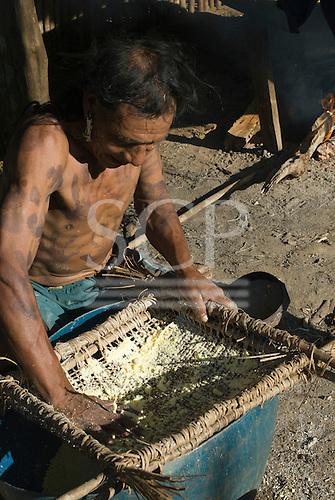 Pará State, Brazil. Aldeia Pukararankre (Kayapo). Making farinha; preparing the manioc.
