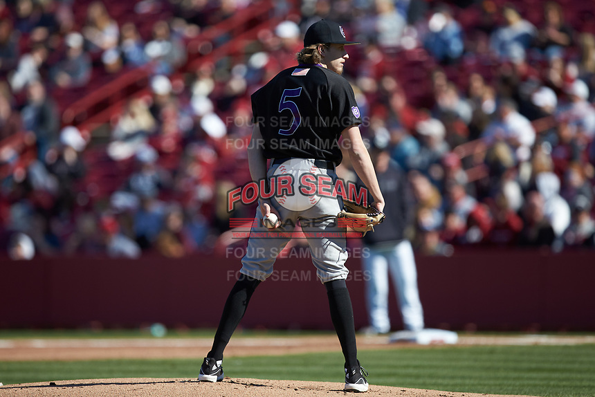 Holy Cross Crusaders starting pitcher Luke Dawson (5) looks to his catcher for the sign against the South Carolina Gamecocks at Founders Park on February 15, 2020 in Columbia, South Carolina. The Gamecocks defeated the Crusaders 9-4.  (Brian Westerholt/Four Seam Images)