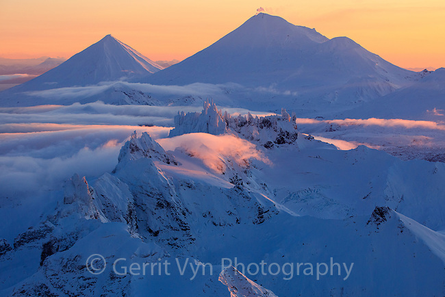 The Aghileen Pinnacles with Pavlof Sister, Pavlof Volcano, and Little Pavlof beyond at dawn. Izembek NWR, Alaska.
